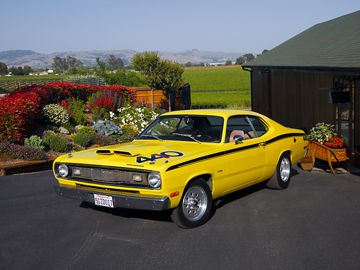 AUT 23 RK1185 01 © Kimball Stock 1972 Plymouth Duster Yellow 3/4 Front View On Pavement