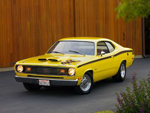 AUT 23 RK1188 01 © Kimball Stock 1972 Plymouth Duster Yellow 3/4 Front View On Pavement