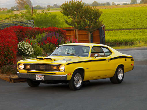 AUT 23 RK1191 01 © Kimball Stock 1972 Plymouth Duster Yellow 3/4 Side View On Pavement