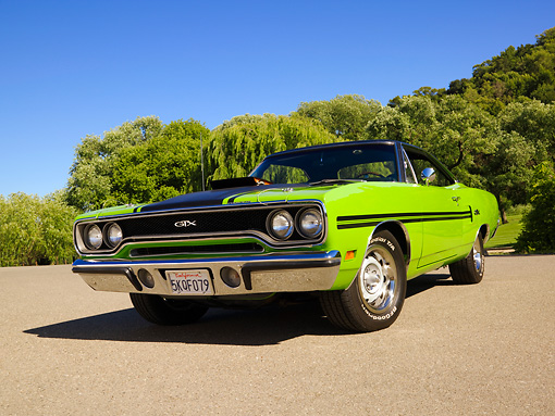 AUT 23 RK1240 01 © Kimball Stock 1970 Plymouth GTX Green Low 3/4 Front View On Pavement