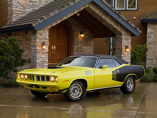 AUT 23 RK1260 01 © Kimball Stock 1971 Plymouth Cuda Yellow 3/4 Front View On Driveway