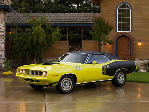 AUT 23 RK1262 01 © Kimball Stock 1971 Plymouth Cuda Yellow 3/4 Side View On Driveway
