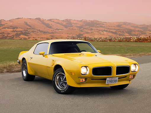 AUT 23 RK1571 01 © Kimball Stock 1971 Pontiac Firebird Trans Am Yellow Low 3/4 Front View On Pavement