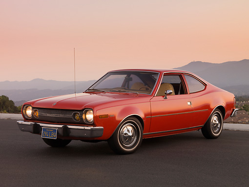 AUT 23 RK1578 01 © Kimball Stock 1974 AMC Hornet Hatchback Red 3/4 Front View On Pavement By Mountains