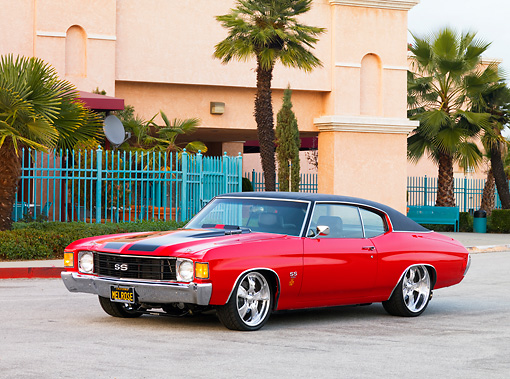 AUT 23 RK1619 01 © Kimball Stock 1972 Chevrolet Chevelle SS Red 3/4 Front View On Pavement By Building
