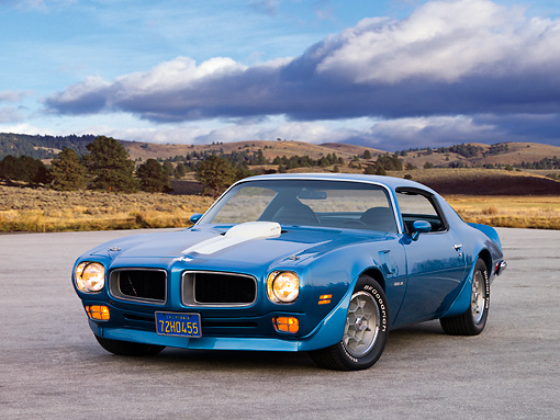 AUT 23 RK1629 01 © Kimball Stock 1972 Pontiac Trans Am Blue 3/4 Front View On Pavement By Trees