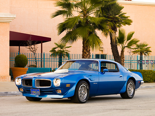 AUT 23 RK1631 01 © Kimball Stock 1972 Pontiac Trans Am Blue 3/4 Front View On Pavement By Building