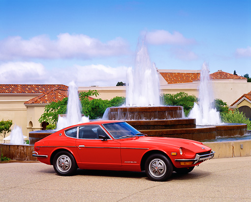 AUT 23 RK1640 01 © Kimball Stock 1972 Datsun 240Z Red 3/4 Front View By Fountain