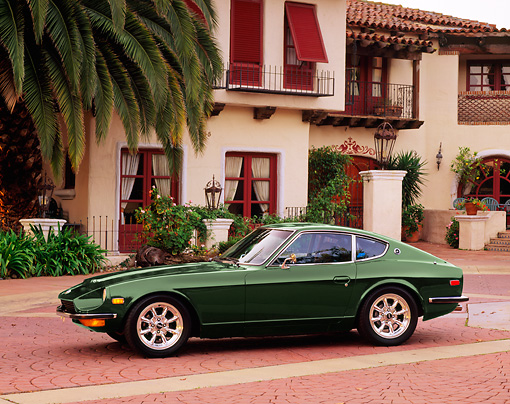 AUT 23 RK1641 01 © Kimball Stock 1972 Datsun 240Z Green 3/4 Front View By Building