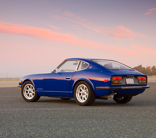 AUT 23 RK1648 01 © Kimball Stock 1971 Datsun 240Z Blue 3/4 Rear View On Pavement At Dusk