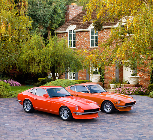 AUT 23 RK1667 01 © Kimball Stock 1972 & 1973 Datsun 240Z Orange 3/4 Front View On Driveway