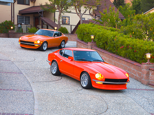 AUT 23 RK1668 01 © Kimball Stock 1972 & 1973 Datsun 240Z Orange 3/4 Front View On Driveway