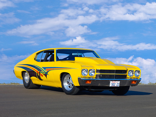 AUT 23 RK1676 01 © Kimball Stock 1970 Chevrolet Chevelle Yellow 3/4 Front View Blue Sky