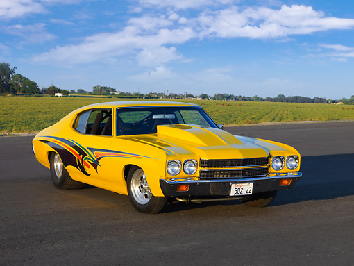 AUT 23 RK1679 01 © Kimball Stock 1970 Chevrolet Chevelle Yellow 3/4 Front View By Field Blue Sky