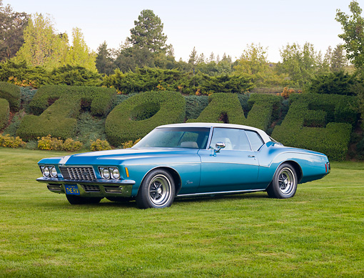 AUT 23 RK1722 01 © Kimball Stock 1972 Buick Riviera Blue 3/4 Front View On Grass By Hedge