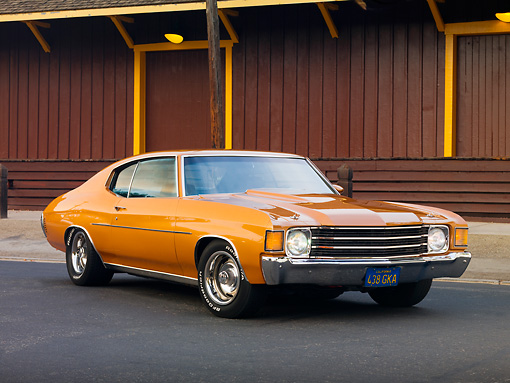 AUT 23 RK1724 01 © Kimball Stock 1972 Chevrolet Chevelle Bronze 3/4 Front View On Pavement By Building