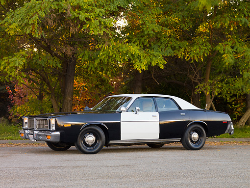 AUT 23 RK1728 01 © Kimball Stock 1977 Dodge Monaco Black And White 3/4 Front View On Road By Trees