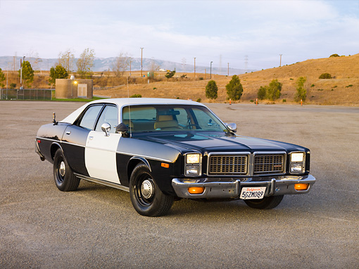 AUT 23 RK1731 01 © Kimball Stock 1977 Dodge Monaco Black And White 3/4 Front View On Pavement By Hills