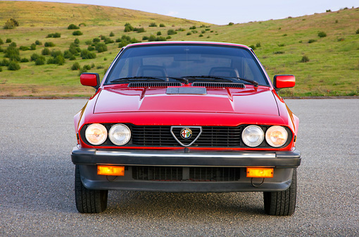 AUT 23 RK1746 01 © Kimball Stock 1981 Alfa Romeo GTV6 Coupe Red Front View On Pavement By Hills
