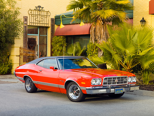 AUT 23 RK1749 01 © Kimball Stock 1973 Ford Gran Torino Sport Red 3/4 Front View On Pavement By Building