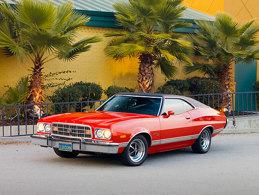 AUT 23 RK1753 01 © Kimball Stock 1973 Ford Gran Torino Sport Red 3/4 Front View On Pavement By Building