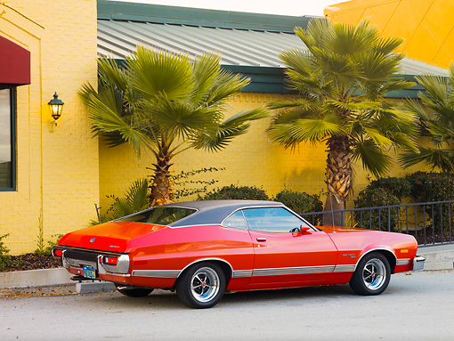 AUT 23 RK1754 01 © Kimball Stock 1973 Ford Gran Torino Sport Red 3/4 Rear View On Pavement By Building