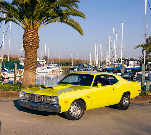 AUT 23 RK1764 01 © Kimball Stock 1974 Dodge Dart Sport Yellow 3/4 Front View On Pavement By Marina