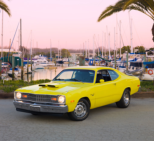 AUT 23 RK1769 01 © Kimball Stock 1974 Dodge Dart Sport Yellow 3/4 Front View On Pavement By Marina