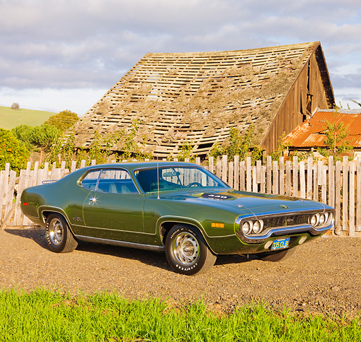 AUT 23 RK1778 01 © Kimball Stock 1971 Plymouth GTX Green 3/4 Front View On Dirt By Fence And Barn