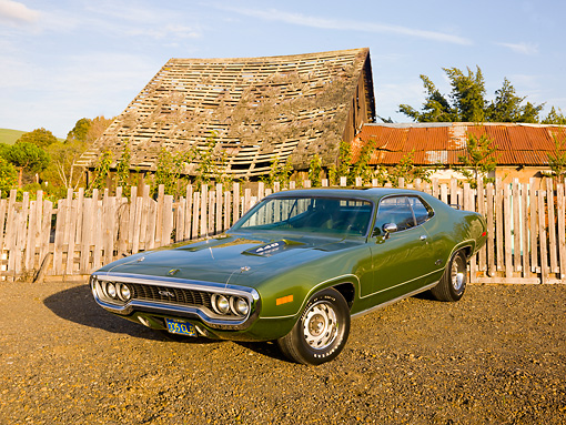 AUT 23 RK1783 01 © Kimball Stock 1971 Plymouth GTX Green 3/4 Front View On Dirt By Fence And Barn