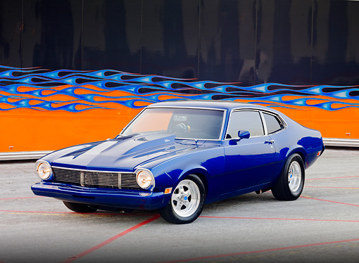 AUT 23 RK1805 01 © Kimball Stock 1973 Ford Maverick Blue 3/4 Front View On Pavement