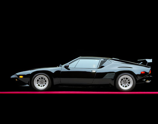 AUT 24 RK0085 02 © Kimball Stock 1987 De Tomaso Pantera GT5-S Black Profile On Red Line Studio
