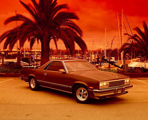 AUT 24 RK0147 02 © Kimball Stock 1986 Chevy El Camino Gray Front 3/4 View On Pavement By Harbor