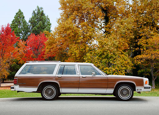 AUT 24 RK0166 01 © Kimball Stock 1988 Mercury Marquis Colony Park White With Wood Panel Profile View On Pavement By Autumn Trees