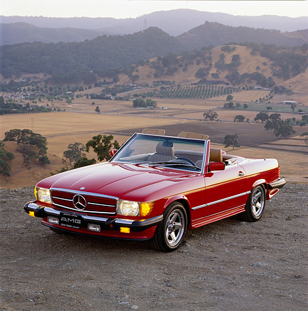 AUT 24 RK0007 02 © Kimball Stock 1987 Mercedes-Benz Convertible Red 3/4 Front View On Dirt By Hills