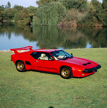 AUT 24 RK0031 07 © Kimball Stock 1986 De Tomaso Pantera GT5-S Red 3/4 Front View On Grass By Lake