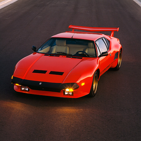 AUT 24 RK0048 02 © Kimball Stock 1986 De Tomaso Pantera GT5-S Red Overhead 3/4 Front View On Pavement