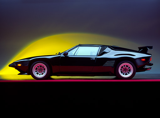 AUT 24 RK0083 02 © Kimball Stock 1987 De Tomaso Pantera GT5-S Black Profile On Red Line Studio