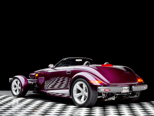 AUT 25 RK0082 06 © Kimball Stock 1998 Plymouth Prowler Roadster Burgundy 3/4 Rear View On Checkered Floor Studio