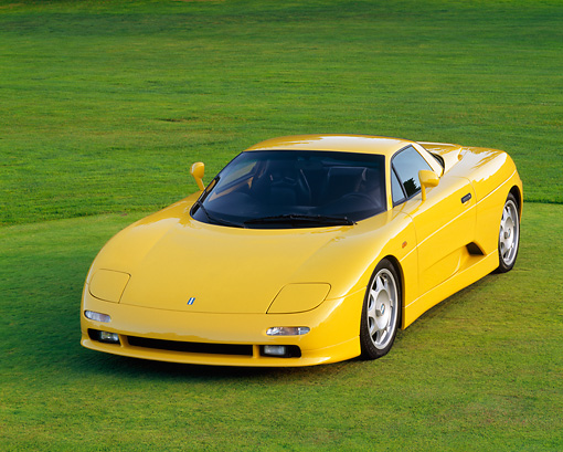 AUT 25 RK0109 09 © Kimball Stock 1996 De Tomaso Guara Yellow Front 3/4 View On Grass