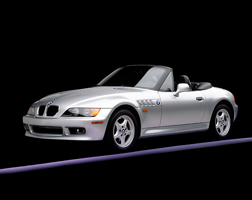 AUT 25 RK0298 03 © Kimball Stock 1996 BMW Z3 Convertible Silver 3/4 Front View On Purple Line Studio