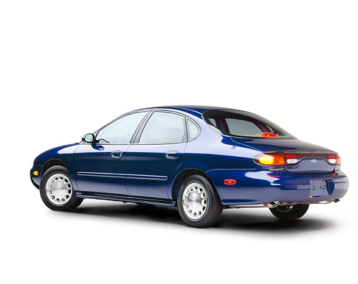 AUT 25 RK0309 05 © Kimball Stock 1996 Ford Taurus Blue 3/4 Rear View On White Seamlesss Studio