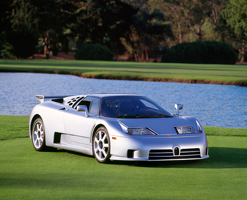 AUT 25 RK0448 03 © Kimball Stock 1994 Bugatti EB110 Silver Front 3/4 View On Grass By Water
