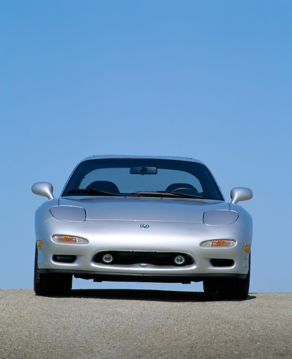 AUT 25 RK0477 02 © Kimball Stock 1992 Mazda RX7 Silver Head On Shot On Pavement Blue Sky