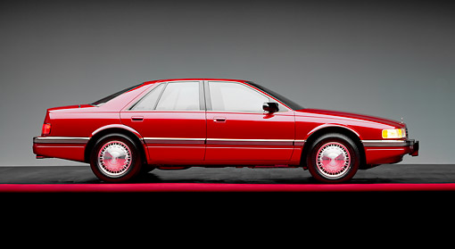 AUT 25 RK0551 01 © Kimball Stock 1992 Cadillac Seville Red Side View On Red Line Studio