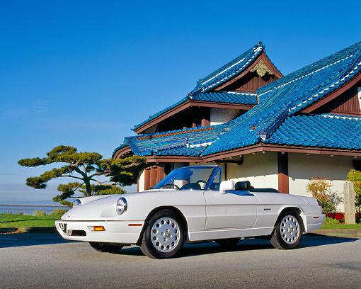 AUT 25 RK0629 08 © Kimball Stock 1994 Alfa Romeo Spider Veloce Convertible White Low 3/4 Side View By Japanese House