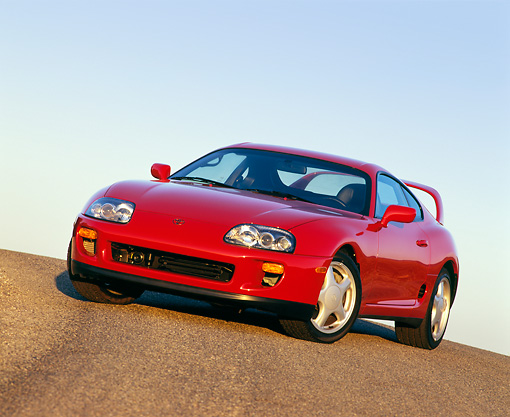 AUT 25 RK0867 02 © Kimball Stock 1993 Toyota Supra Red 3/4 Front Slanted View On Pavement Hill Blue Sky