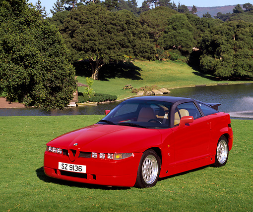 AUT 25 RK0947 06 © Kimball Stock 1998 Alfa Romeo Sprint Zagato SZ100 Red 3/4 Front View On Grass By Water