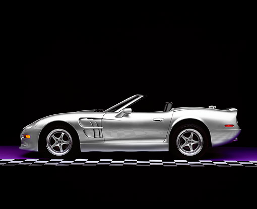 AUT 25 RK1123 06 © Kimball Stock 1999 Shelby Series 1 Convertible Silver Side View On Purple Floor Checkered Line Studio