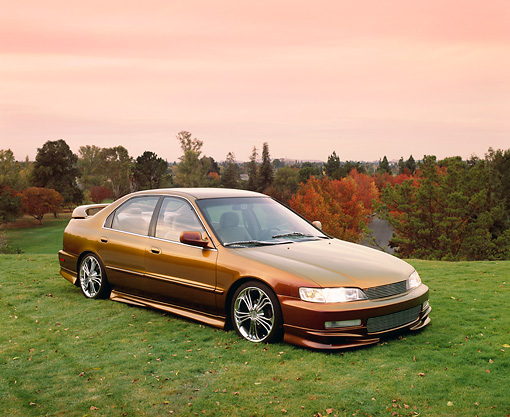 AUT 25 RK1257 04 © Kimball Stock 1996 Honda Accord DX Custom Bronze 3/4 Side View On Grass Hill Filtered